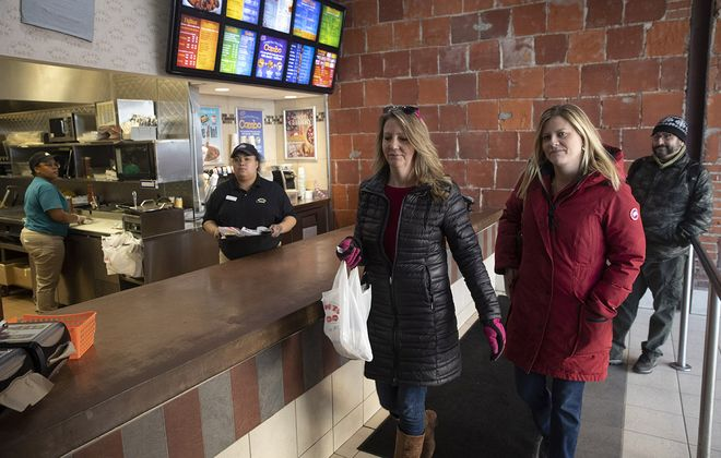 Teri Syracuse of Hamburg and Sally Venditti of Lake View pick up lunch at Mighty Taco on Chippewa Street on Friday, Feb. 21, 2020. (John Hickey/Buffalo News)