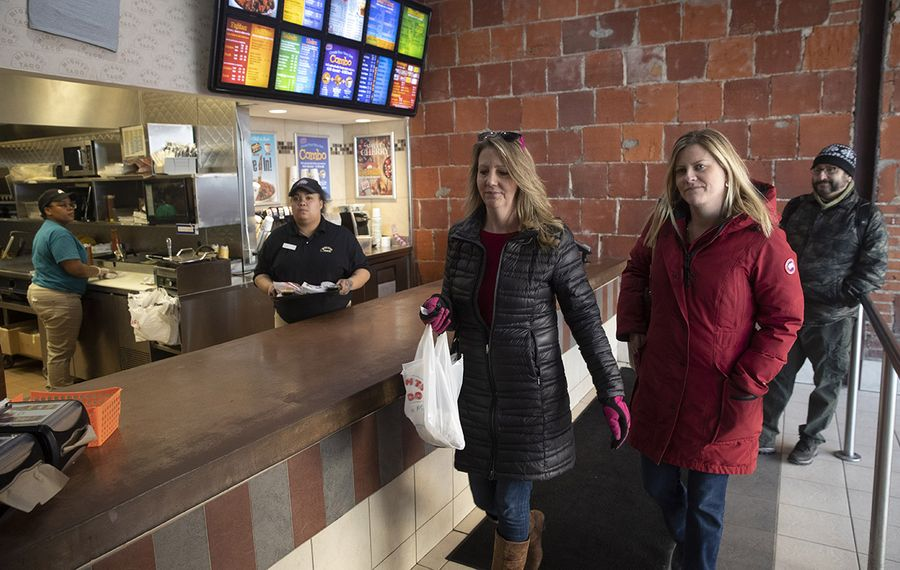 Teri Syracuse of Hamburg and Sally Venditti of Lake View pick up lunch at Mighty Taco on Chippewa Street on Friday, Feb. 21, 2020. (John Hickey/Buffalo News)