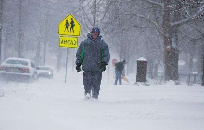 Michael Wagner walks through the snow Thursday on Union Street in Hamburg. (Mark Mulville/Buffalo News)