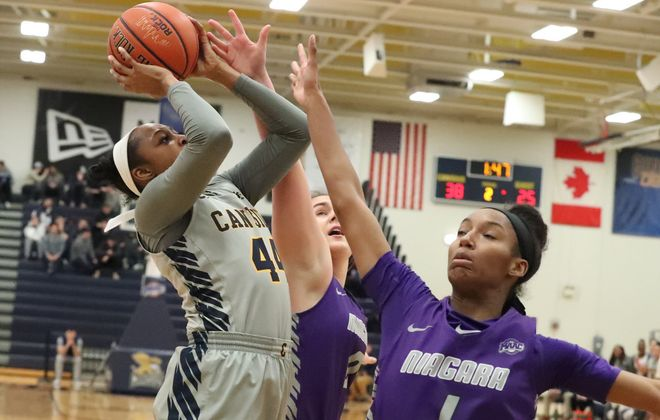 Canisius Golden Griffins forward Danielle Sanderlin (44) scores two points over Niagara Purple Eagles guard Jordan Edwards (1) in the first half at Canisius College on Monday, Feb. 24, 2020. (James P. McCoy/Buffalo News)