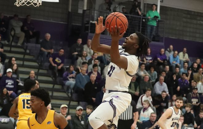 Niagara Purple Eagles forward Greg Kuakumensah (15) scores two points over Canisius Golden Griffins guard Majesty Brandon (15) in the first half at Niagara University's Gallagher Center  on Wednesday, Feb. 12, 2020. (James P. McCoy/Buffalo News)