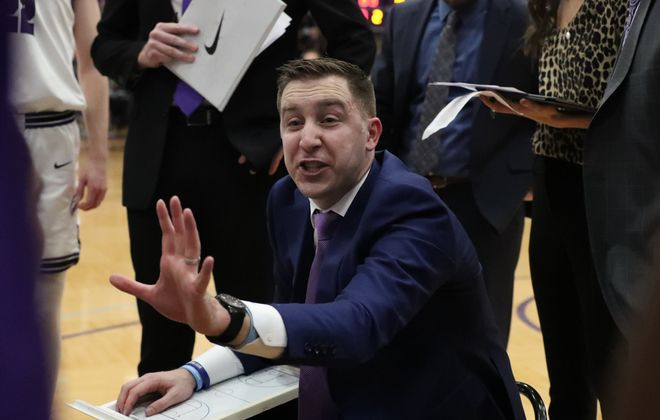 Niagara Purple Eagles head coach Greg Paulus talks to his team during a time out in the second half at Gallagher Center, Niagara University on Wednesday, Feb. 12, 2020. (James P. McCoy/Buffalo News)