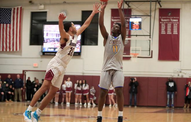 Canisius' Dewayne Vass shoots against St. Joe's. He flirted with a triple-double in helping the Crusaders win at St. Joe's on Friday night. (Harry Scull Jr./Buffalo News)