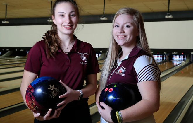 Melissa Large from Tonawanda High School (left) and Makayla Pasierb from Dunkirk High School each bowled their first career 300 game at the Section VI girls bowling tournament at the Airport Lanes on Thursday, Feb. 13, 2020. (Harry Scull Jr./Buffalo News)