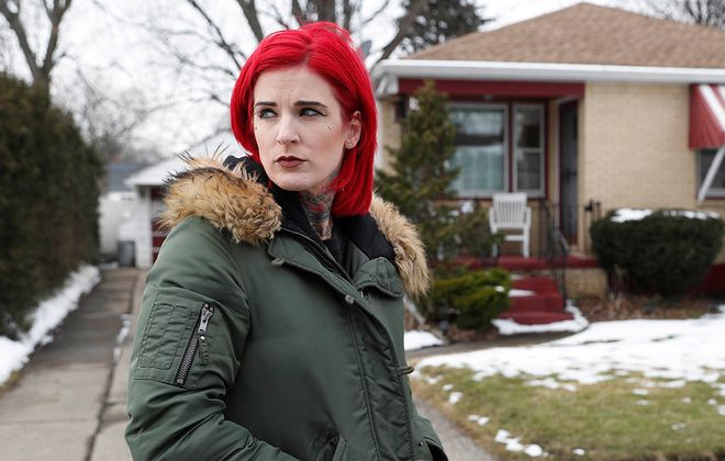 Andrea D'Alimonte filed a Child Victims Act lawsuit against her father, who was convicted of sexually abusing her, and her mother. She stands in front of the house in Cheektowaga where she grew up and was abused. (Sharon Cantillon/Buffalo News)