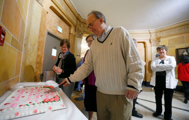 Sal Buscaglia cuts a piece of his birthday cake at Mercy Hospital. Buscaglia thanked all the people who saved his life after he suffered a massive heart attack in June 2019. (Mark Mulville/Buffalo News)