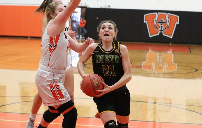 Williamsville North's Marcie Colca scores two points over  Wilson's Isabel Dinse in the second quarter in the Lakewomen Post Season Prep Tournament Saturday. Will North won, 57-47. (James P. McCoy/Buffalo News) Wilson high school in Wilson,N.Y. on Saturday, Feb. 15, 2020. (James P. McCoy/Buffalo News)