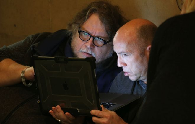 "Director Guillermo del Toro, left, and producer J. Miles Dale, take a break from filming in Buffalo City Hall to talk about the filming schedule and progress. They are shooting scenes for ""Nightmare Alley"" in Buffalo. (Robert Kirkham/Buffalo News)"