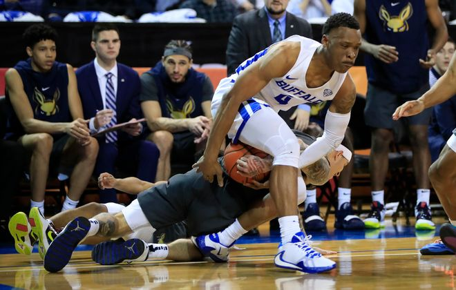 University at Buffalo player Davonta Jordan takes a loose ball from Akron player Channel Banks during the first half at Alumni Arena, on Saturday, Feb. 29, 2020. (Harry Scull Jr./Buffalo News)