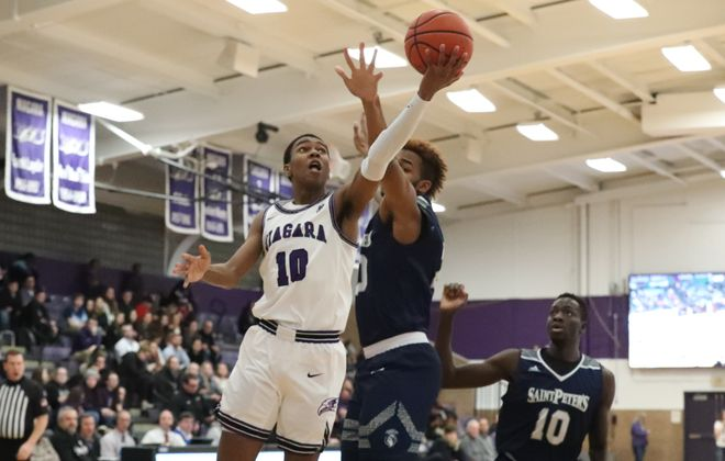 Niagara Purple Eagles guard Marcus Hammond (10) scores two points over St. Peter's Peacocks forward Derrick Woods (20) in the first half at Gallagher Center, Niagara University   in Lewiston,N.Y. on Thursday, Feb. 27mes P. McCoy/Buffalo News)