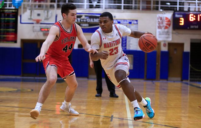 John Washington drives around Southwestern player Mitchell Pascarella during the first half of their Section VI playoff game Wednesday at St. Mary's School for the Deaf. (Harry Scull Jr./Buffalo News)
