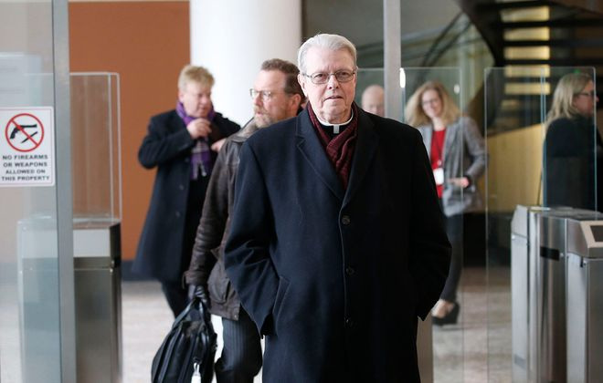 Bishop Edward Scharfenberger exits the Robert H. Jackson U.S. Courthouse after the bankruptcy hearing Feb. 28, 2020. (Robert Kirkham/Buffalo News)