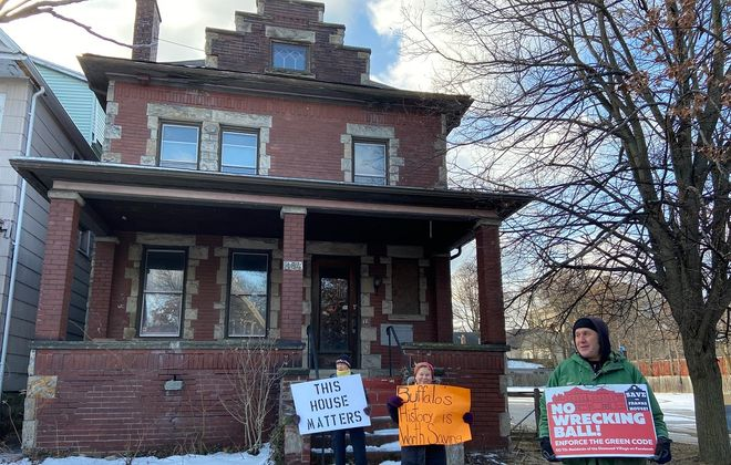 Opponents of the proposed demolition of 184 West Utica St. gathered Saturday morning to draw attention to the effort to save the building. (Aaron Besecker/Buffalo News)