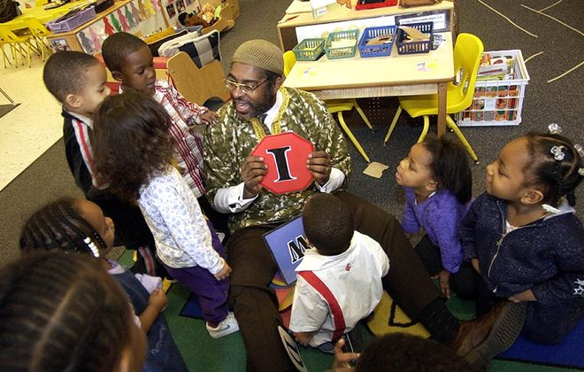 Community Action Organization Executive Director L. Nathan Hare is surrounded by children at a Head Start class at Memorial Temple in Buffalo. (Robert Kirkham/News file photo)