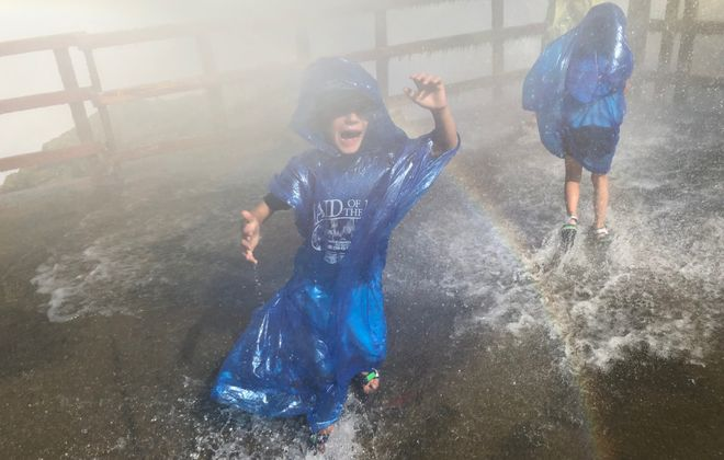 Nature is unleashed on the Hurricane Deck, so much so it was hard to make out who's who beneath the blue ponchos with all the spraying water. (Jeff Bucki)