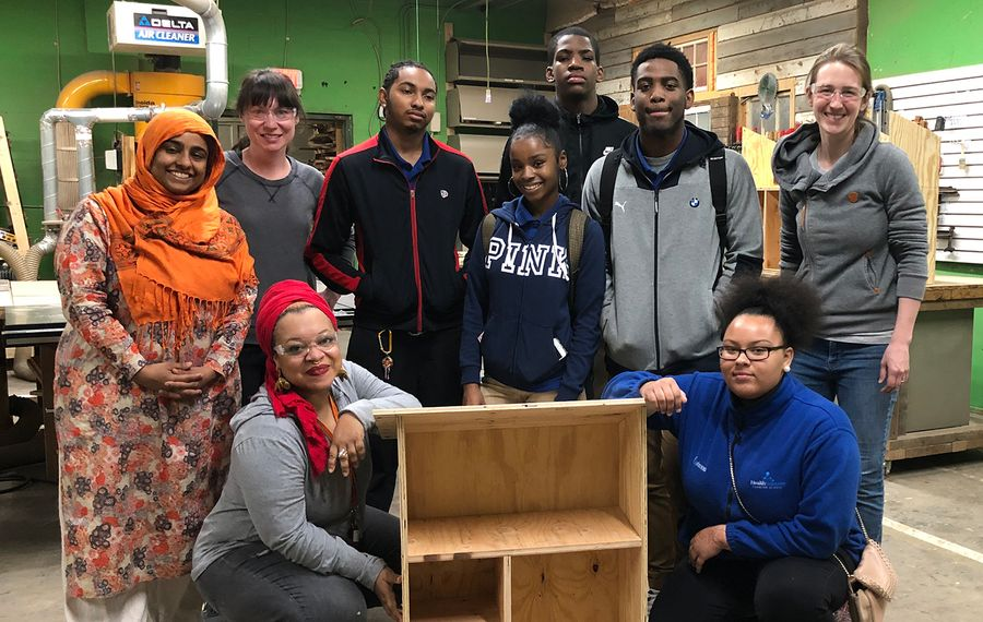 Drea d'Nur, founder of the nonprofit Feed Buffalo, and volunteers building a Little Free Pantry. (Feed Buffalo)