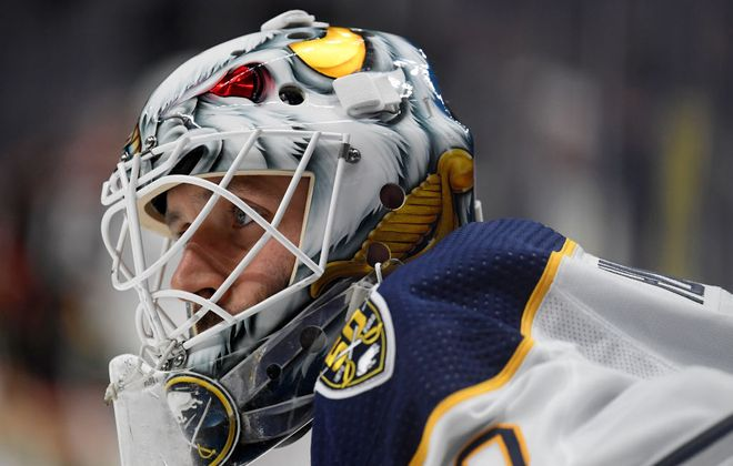 Sabres goalie Carter Hutton allowed four goals on 14 shots in the first period. (Getty Images)