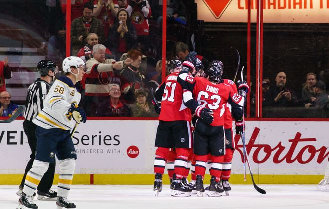 Artem Anisimov (51) of the Ottawa Senators celebrates his first-period, power-play goal against the Buffalo Sabres with teammates Tyler Ennis (63) and Connor Brown (28) as Victor Olofsson (68) of the Buffalo Sabres skates away at Canadian Tire Centre on Feb. 18, 2020 in Ottawa, Ont. (Jana Chytilova/Freestyle Photography/Getty Images)