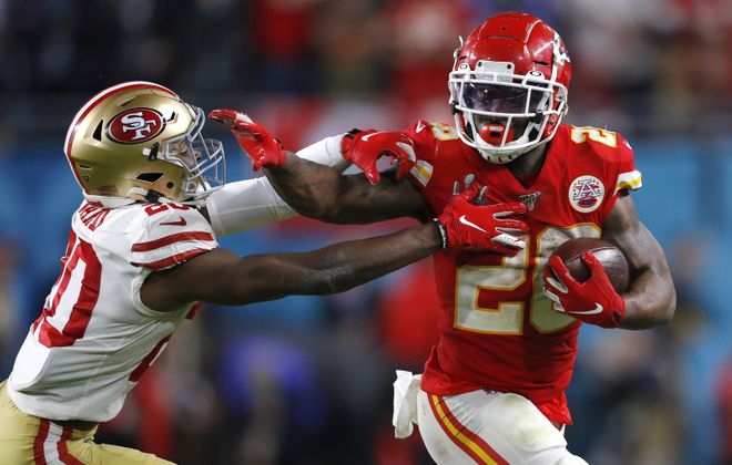 Damien Williams of the Kansas City Chiefs gives a stiff arm. (Kevin C. Cox/Getty Images)
