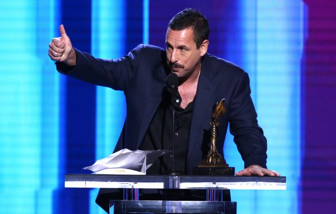 Adam Sandler, pictured accepting an award in Santa Monica, Calif., is coming to Buffalo. (Getty Images)