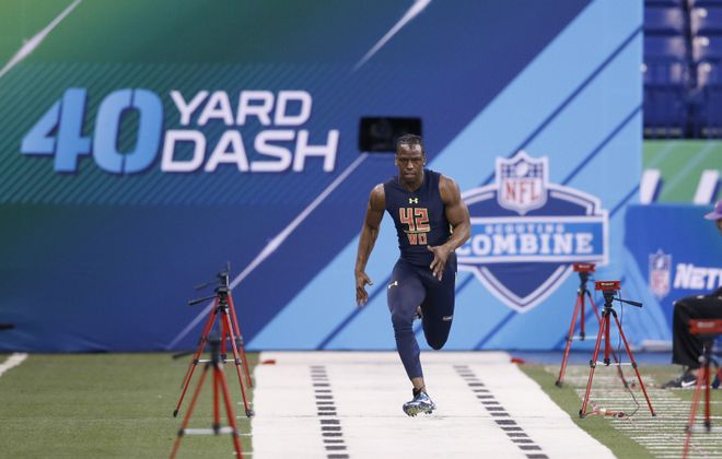Wide receiver John Ross holds the record for the 40-yard dash at the scouting combine. (Joe Robbins/Getty Images)