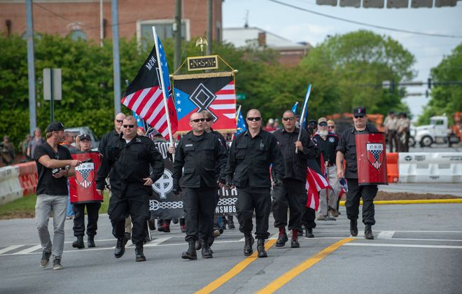 Members of the National Socialist Movement and other white nationalists march toward the entrance to Greenville Street Park in Newnan, Ga., on April 21, 2018. (Bita Honarvar/AFP via Getty Images)