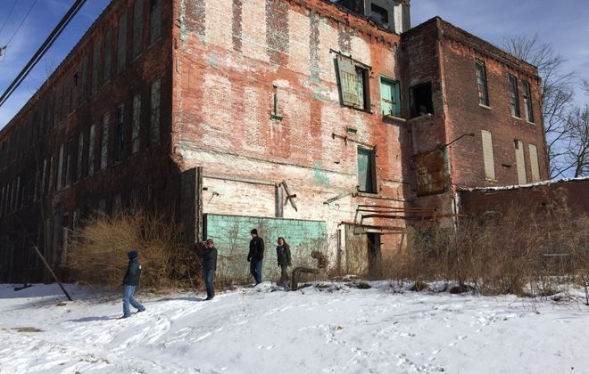 City housing inspectors start their blitz of neglected properties at the former Goodwill distribution center on Guilford Street Saturday. (Barbara O'Brien/Buffalo News)