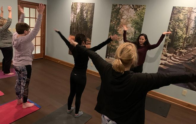 Monica Zucco, owner of Yoga for Every Body Buffalo, leads a recent gentle flow yoga class at Explore What's Next mental health counseling center in Amherst. (Scott Scanlon/Buffalo News)