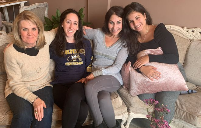 Four women have had a hand in Her Kitchen, a plant-based cooking class and wellness series they hope will also lead to other collaborations. They are, from left, Sally Gower, owner of Eat Well Buffalo; Sarah Nasca, co-owner of Askher's juice cafes; and Susan Morreale and her daughter, Ciara, owners of Her Story Boutique. (Photo courtesy of Her Story Boutique)