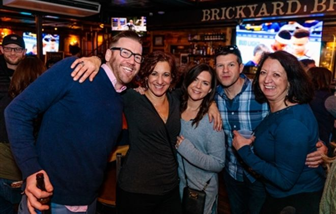 Smiles at Brickyard's Pub & BBQ's 15th anniversary party
