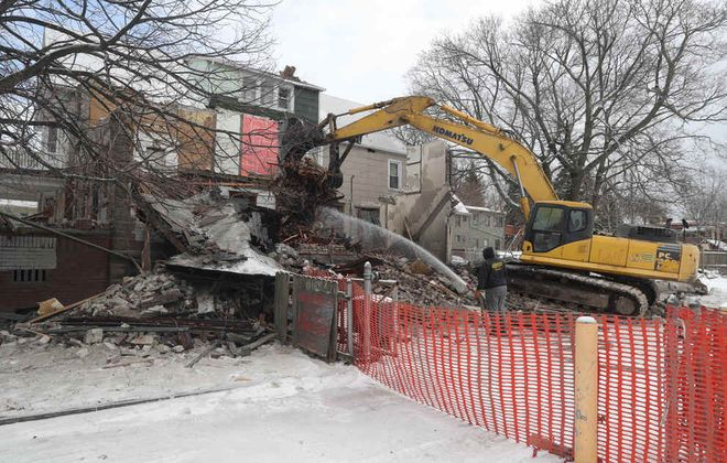 A demolition crew tore down 184 W. Utica St. on Feb. 27. The green light by the city came two days after the Buffalo Preservation Board voted unanimously to landmark the 1907 building designed by Albert Schallmo, an architect who worked on the acclaimed Blessed Trinity Church on the East Side. (John Hickey/Buffalo News)