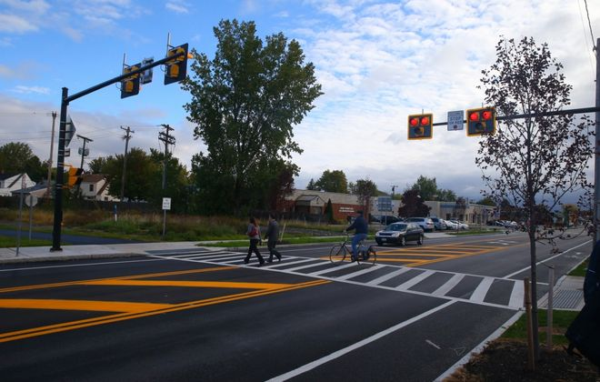 Three Erie County communities have installed high-intensity activated crosswalk beacons, known as HAWKs, at midblock points, including this one on Kenmore Avenue in the Town of Tonawanda. (John Hickey/News file photo)