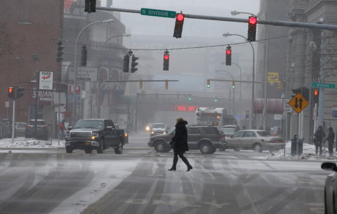 A lane on Washington Street would be designated for bicycles and electric scooters under scenarios discussed Saturday. Experts also sketched plans for North and South Division streets that would reduce the number of lanes for vehicular traffic from three to one. (John Hickey/Buffalo News file photo)