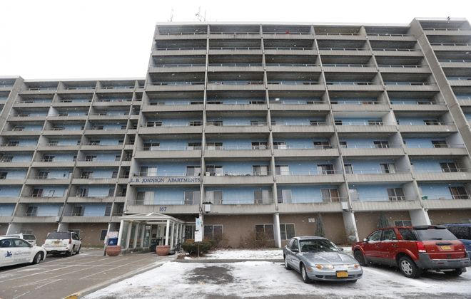 An evicted tenant died after apparently falling from the LBJ Apartments, a 10-story building at 167 W. Humboldt Parkway in Buffalo. Residents say Allan Quigley was using a rope to climb from the roof of the high-rise to his 9th floor apartment balcony when he fell at about 2:40 a.m. and landed to the right of the front entrance. (Sharon Cantillon/Buffalo News)