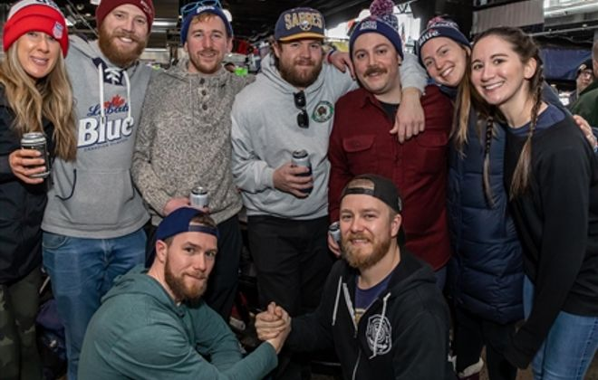 Smiles at Labatt Blue Pond Hockey Tournament in RiverWorks