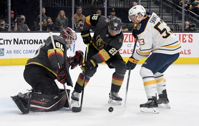 Jeff Skinner gets a shot on goalie Robin Lehner during the first period Friday night as Vegas defenseman Nick Holden moves in (Getty Images).