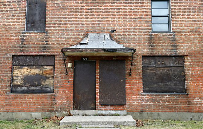 A boarded-up section of the Perry Street complex. (Mark Mulville/News file photo)
