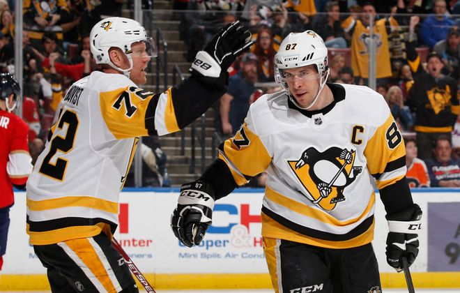 Sidney Crosby, right, and  Patric Hornqvist have both missed large amounts of time with the Penguins due to injuries this season. (Getty Images)