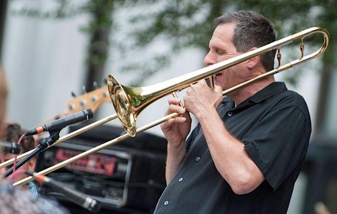 Philip R. Sims plays the trombone. (News file photo)