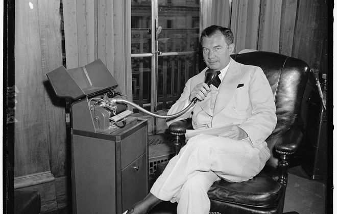 Robert H. Jackson uses a dictation machine in his Washington, D.C., office in 1940. (Photo by Harris & Ewing/Library of Congress)