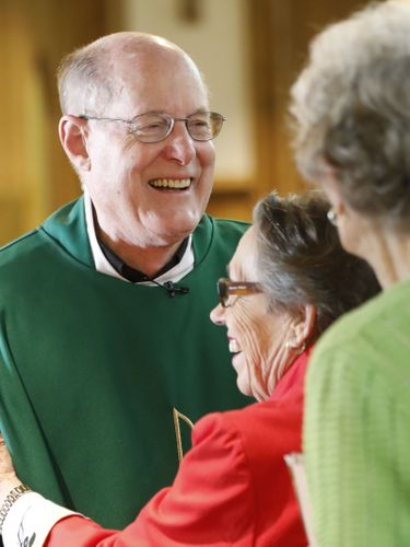 Rev. Dennis Riter, pastor of St. Elizabeth Ann Seton Catholic Church in Dunkirk, greets parishioners following Mass on July 1, 2018. Riter died Saturday, Feb. 8, 2020. The Buffalo Diocese cleared Riter in 2018 of allegations that he sexually abused two children, but two lawsuits are pending over the alleged abuse. (Derek Gee/Buffalo News)
