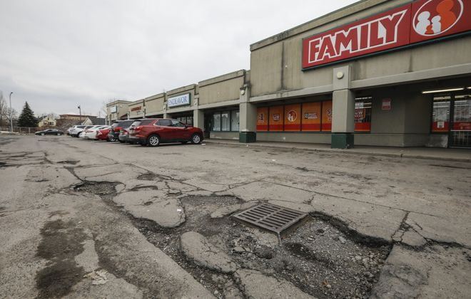 Crumbling pavement at the Towne Gardens Shopping Plaza in Buffalo on Jan. 31, 2020. (Derek Gee/Buffalo News)