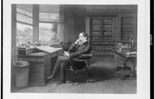 Charles Dickens in his study, portrait by Samuel Hollyer, circa 1875.
