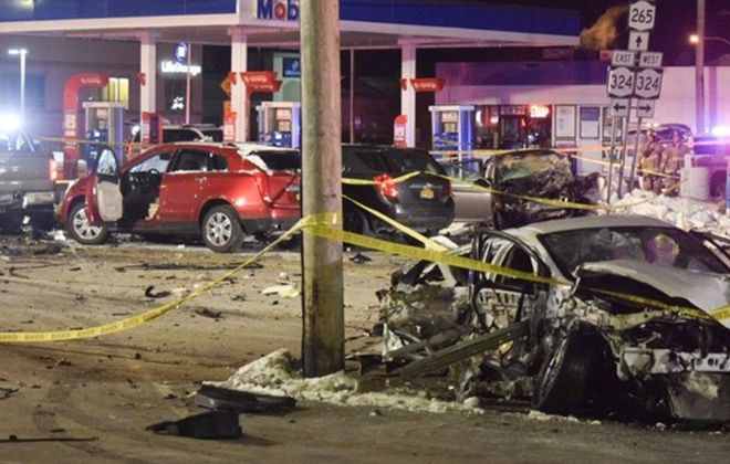 A crash late Friday night at Sheridan Drive and Military Road claimed the lives of two people. (Brian Fose Photography)