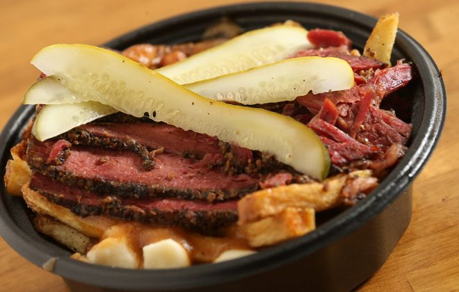 The Allen Street Poutine version of poutine with smoked meat – the pastrami of Canada – heads News Food Editor Andrew Galarneau's short list of favorites. (Sharon Cantillon/Buffalo News)