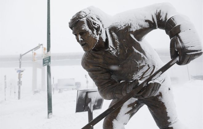 The Tim Horton statue at Canalside, amid the Blizzard of 2019. (Derek Gee/Buffalo News)