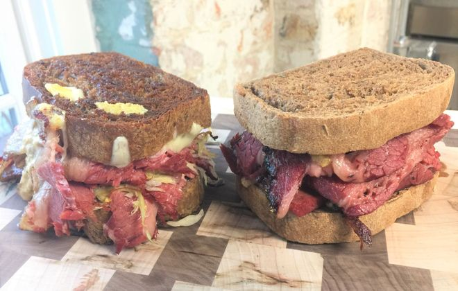 Reuben, left, and pastrami Primal, right, can be ordered from Dark Rose Deli. (Andrew Galarneau/Buffalo News)