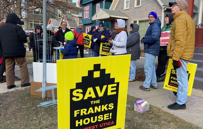Supporters of an effort to save the Ernest Franks House gathered Saturday on West Utica Street. (Aaron Besecker/Buffalo News)