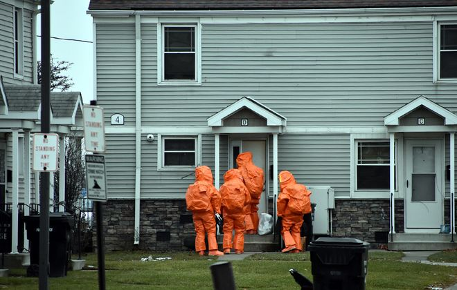 An investigation by the FBI's Joint Terrorism Task Force culminated in a December 2018 raid at the Packard Court apartment where Jeffrey Richards lived with his mother. A follow-up raid that month, pictured here, included the Niagara County Hazmat team. (Larry Kensinger/Special to The News)