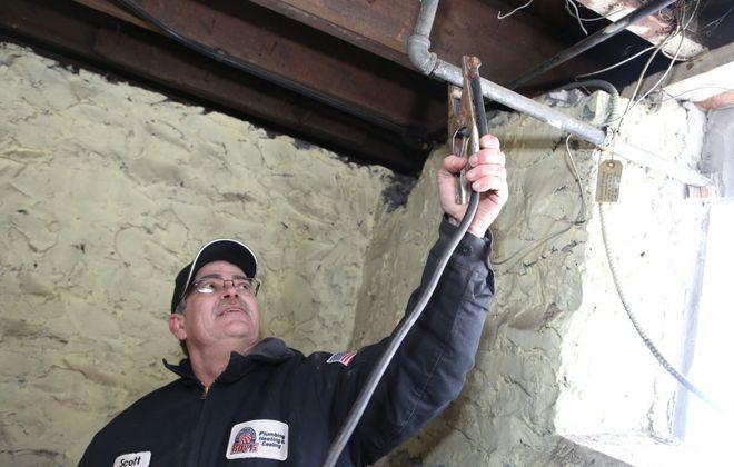 Plumber Scott Graves thaws a pipe. (Robert Kirkham/Buffalo News)
